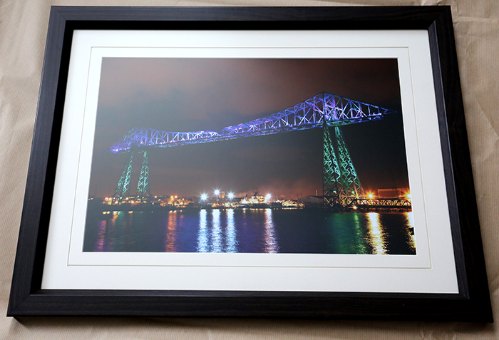 18x12 print in dark wood framed print with off white v grooved mount and non reflective glass